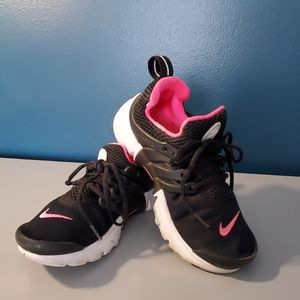 Size 13 Youth Nike Black sneakers with pink logo.